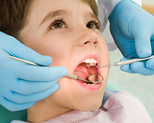 Young boy getting sealants to prevent cavities